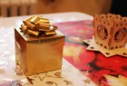 Nice golden christmas gift and wooden candlestick